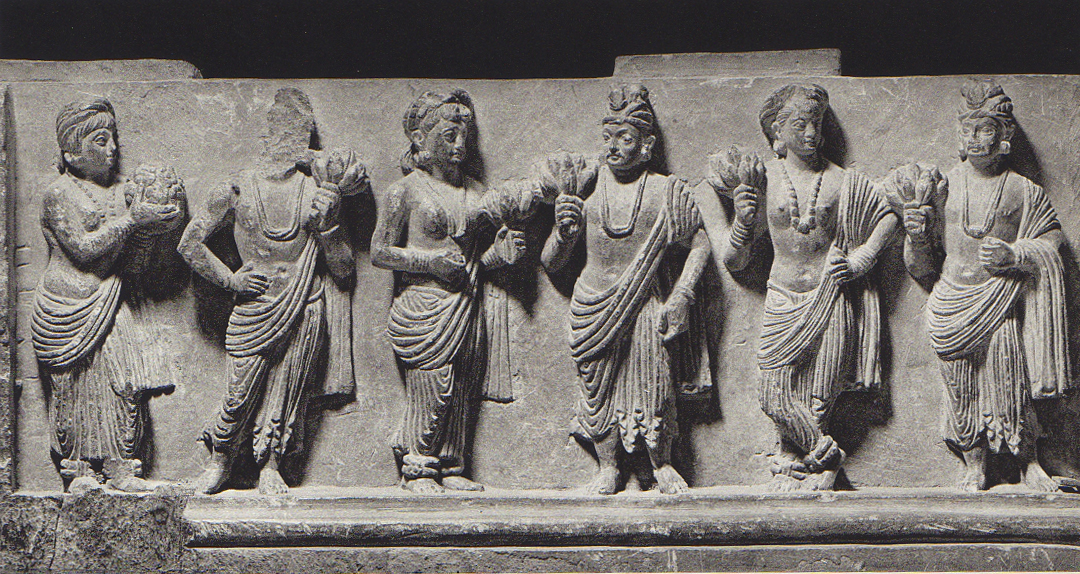 A convivial gathering of men and women in ancient Pakistan.  The style of art, known Gandharan, drew on influences from India, Persia and Greece.