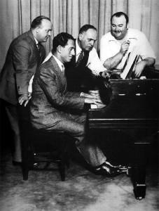 (L-R) Ferde Grofé, George Gershwin, the impressario Roxy Rothafel, Paul Whiteman